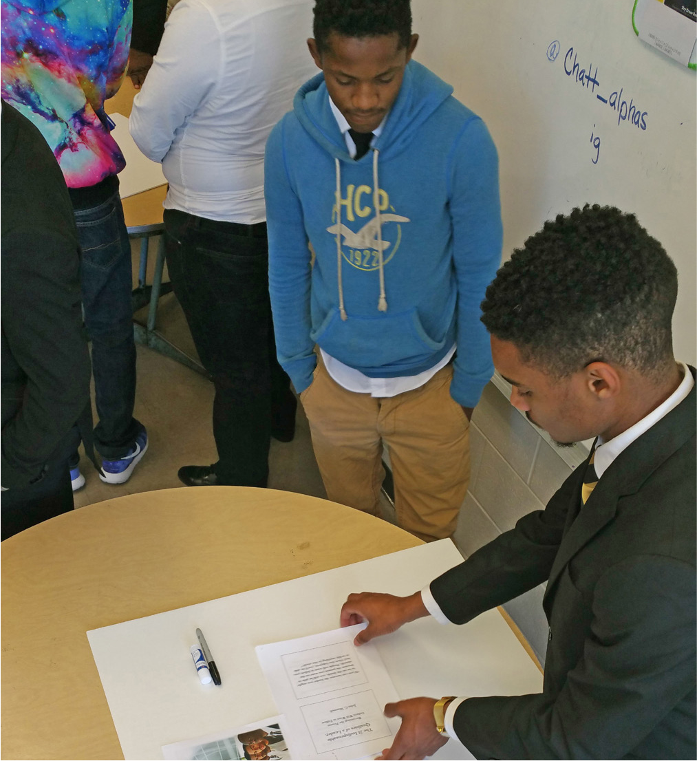 Dequantez Sandifer (right), a UTC student from the university's Alpha Phi Alpha chapter, works with a ninth-grade Howard High School student on a breakout session about character building.